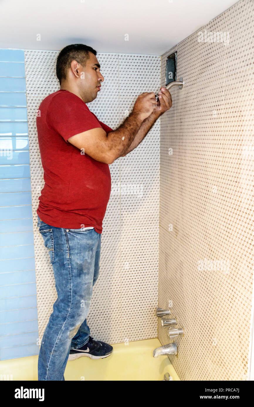 Miami Beach Florida Contractor Hispanic Man Bathroom Plumbing Shower  Installation Installing Working   Stock Image