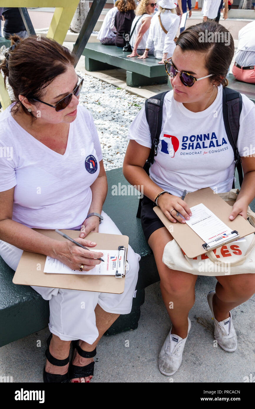 Miami Florida political petition survey questionnaire woman completing filling in answering canvassing Donna Shalala - Stock Image