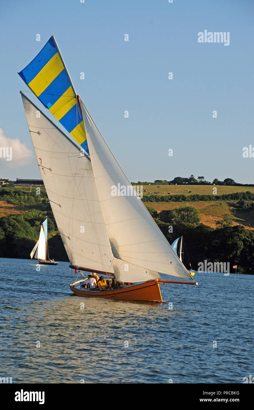 Traditional Falmouth working boat under sail in the Fal estuary Stock Photo