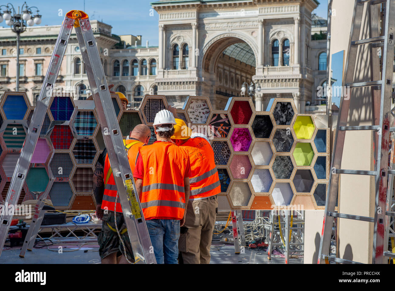 Milan Italy September 26th 2018: workers who dismantle the artistic installation in Piazza Duomo in Milan - Stock Image