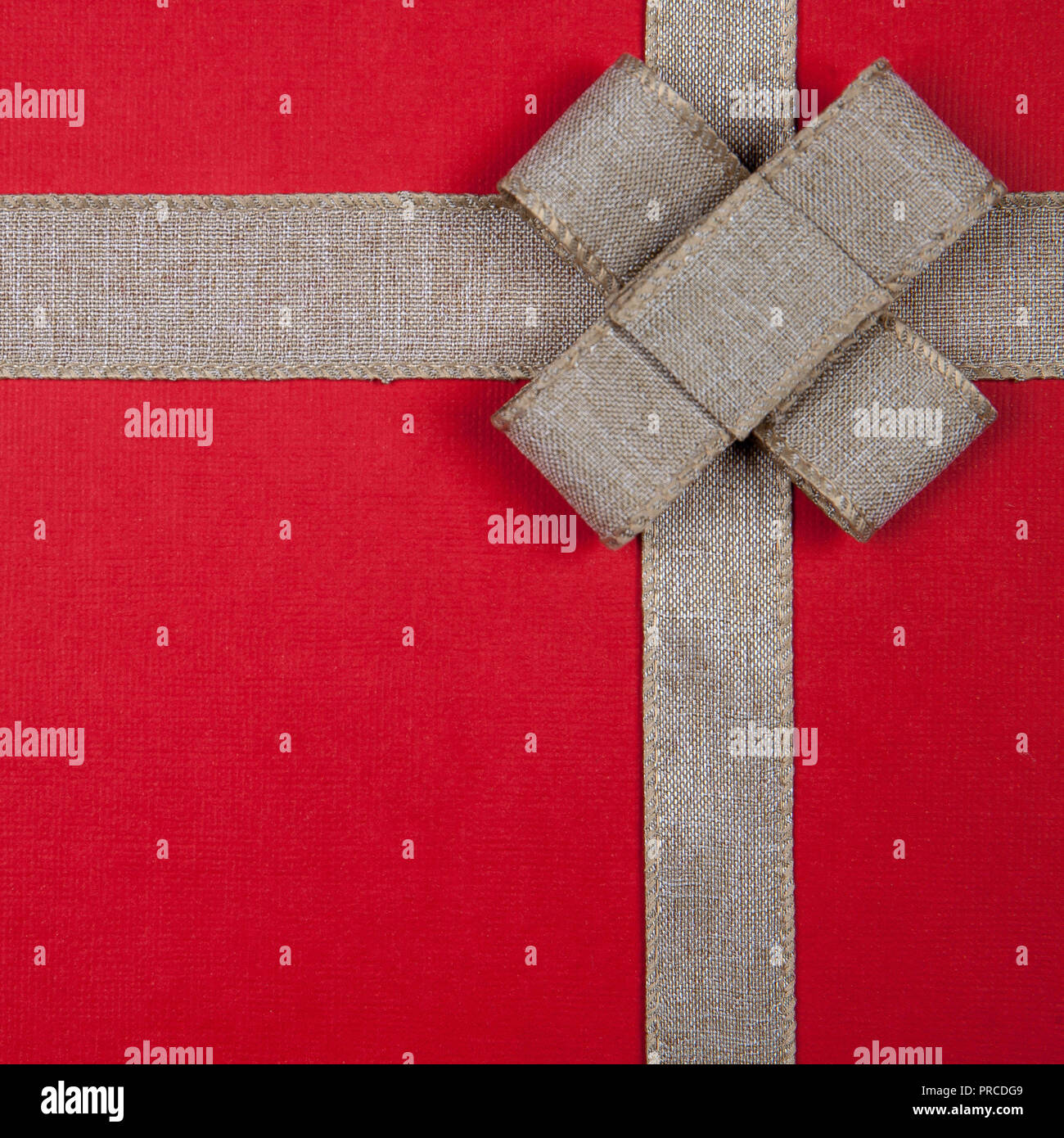 burlap ribbon on a red christmas gift background