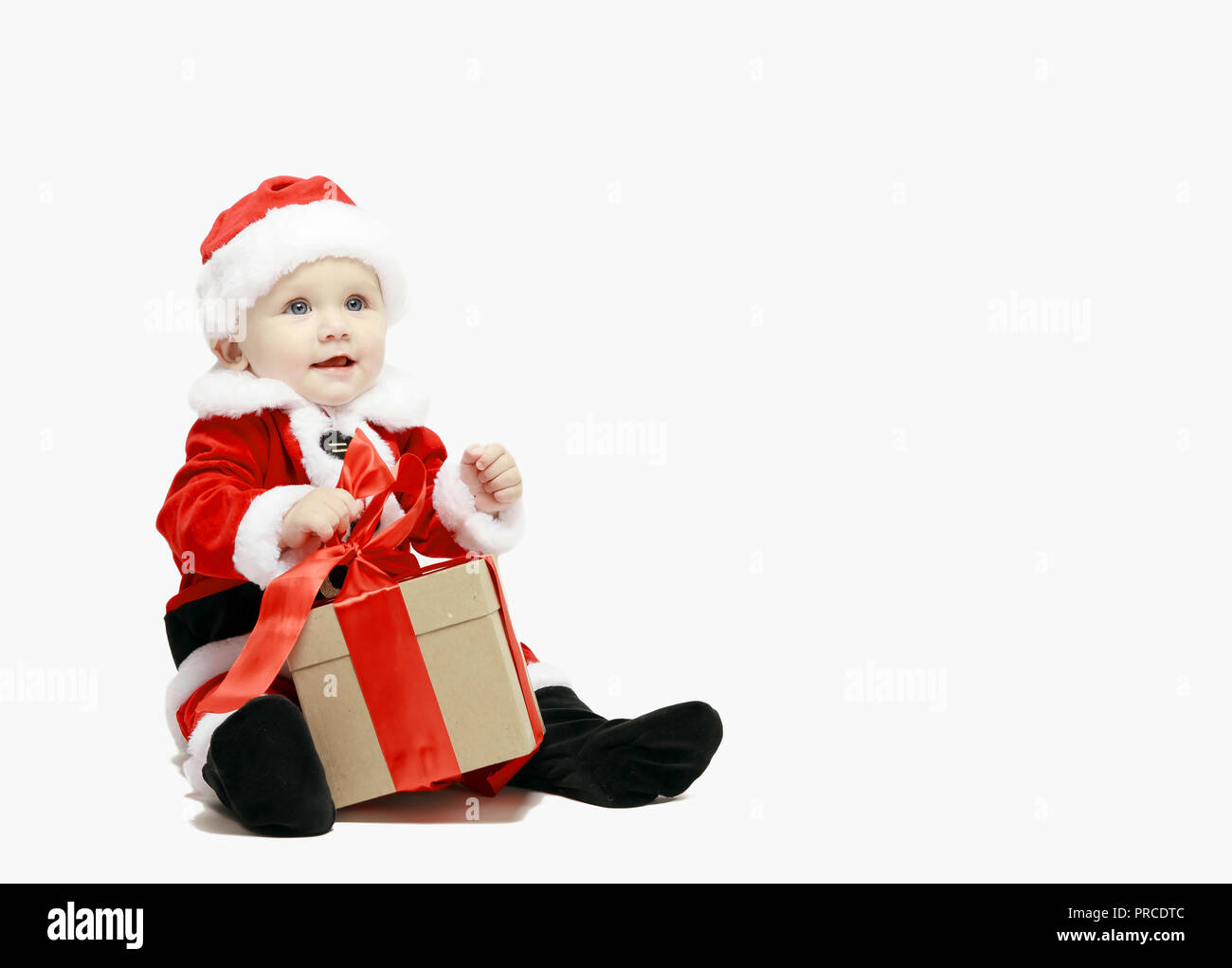 06c11bded22 Santa Claus baby in red christmas clothes with gift box isolated on white  background - Stock