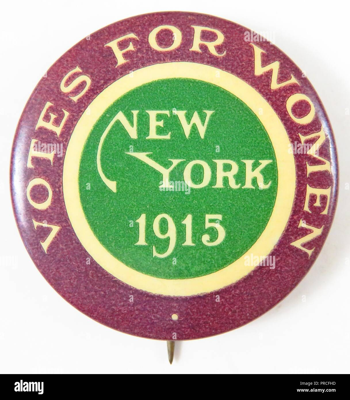 Purple, green, and white (or cream) suffrage pin, with the text 'Votes for Women, New York 1915, ' manufactured for the American market, by the Women's Political Union of New York, with colors borrowed from English suffrage organizations, 1915. Photography by Emilia van Beugen. () - Stock Image