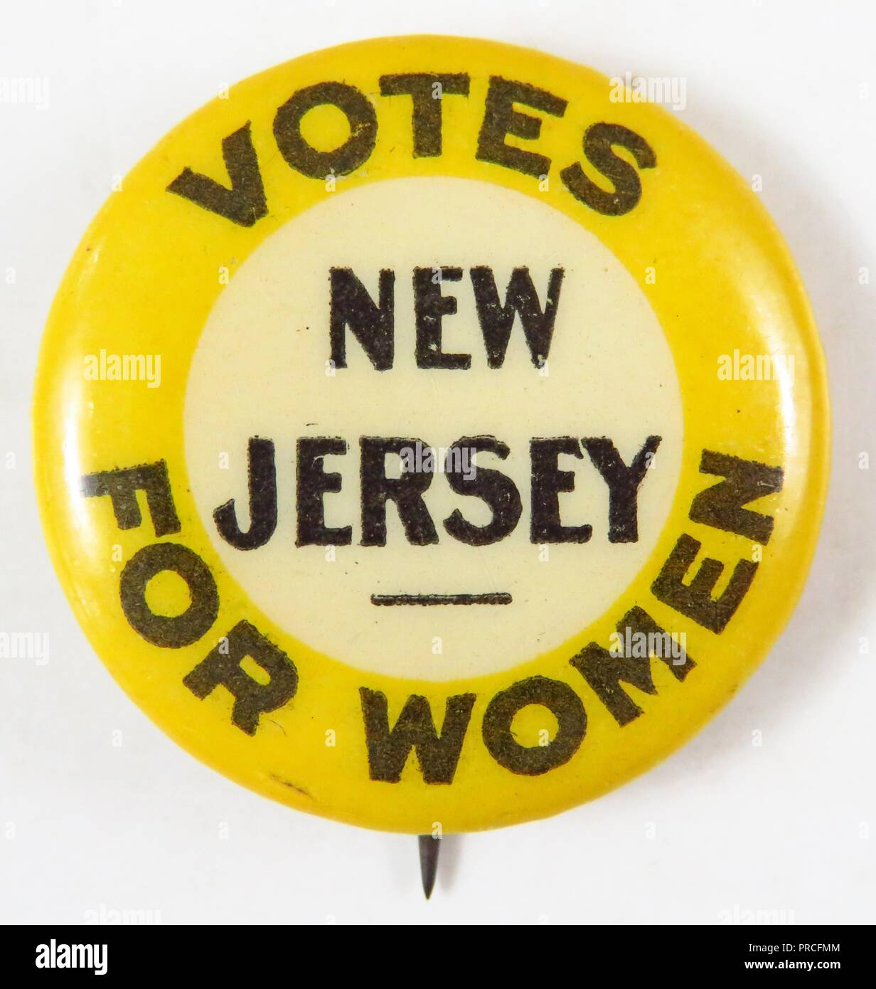 Yellow, black, and white suffrage pin, with the text 'Votes for Women, New Jersey, ' manufactured or the American market, by the New Jersey Woman Suffrage Association, 1915. Photography by Emilia van Beugen. () - Stock Image