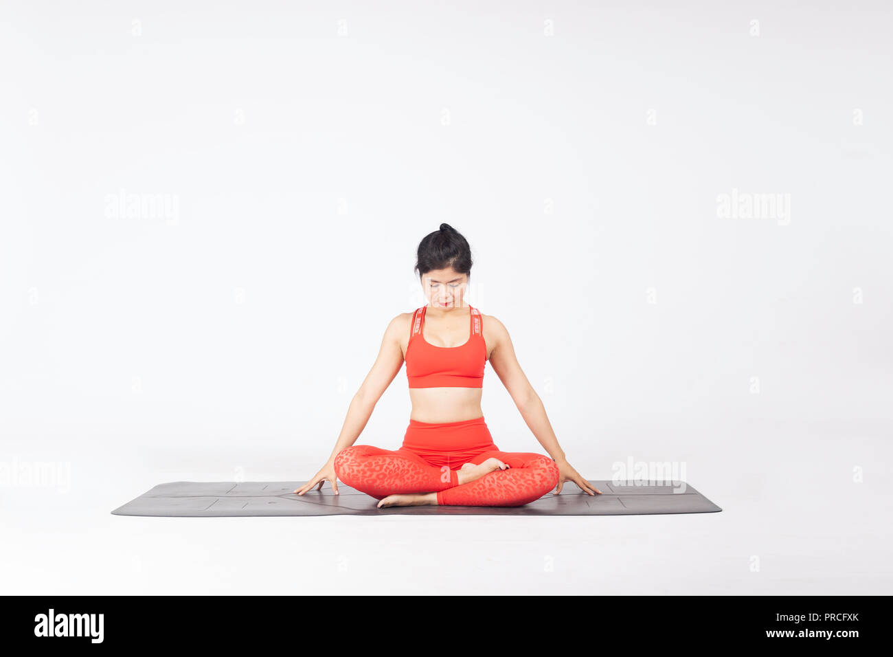 Woman practicing yoga - Stock Image