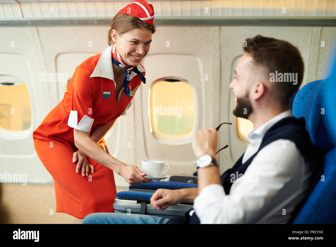 Flight Attendant at Work - Stock Image