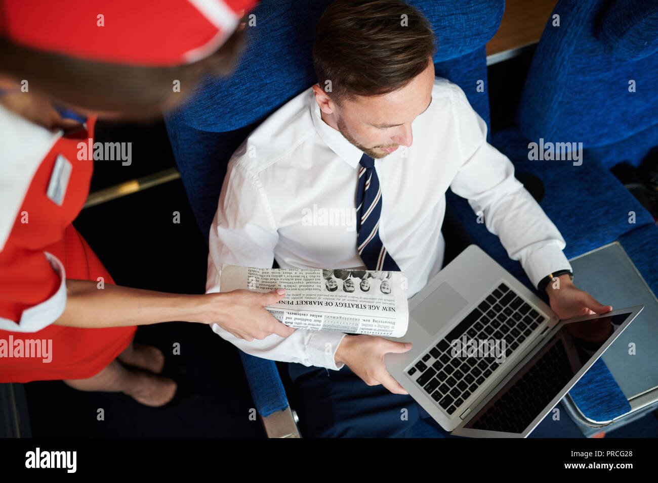 Businessman in First Class - Stock Image