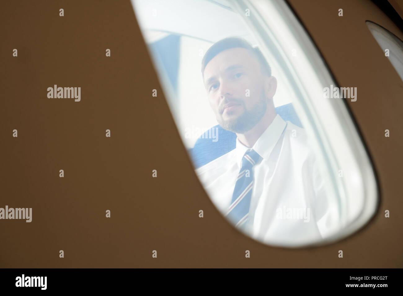 Passenger in Plane - Stock Image