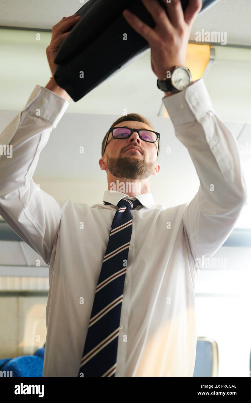 Businessman Taking Baggage - Stock Image