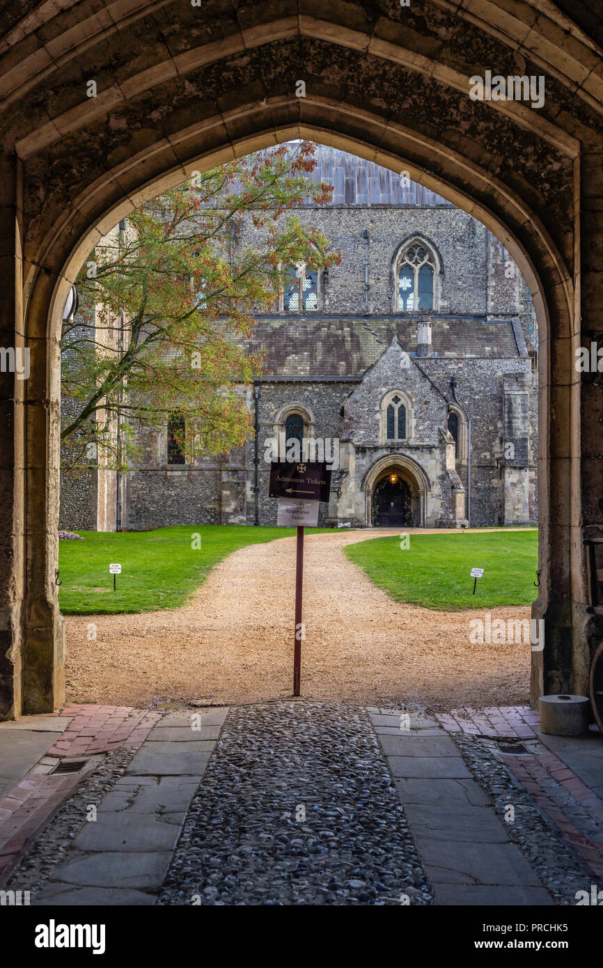 Arch doorway entrance to the hospital of St Cross and Almshouse of the Noble poverty - a medieval almshouse grade 1 listed building in Winchester, UK Stock Photo