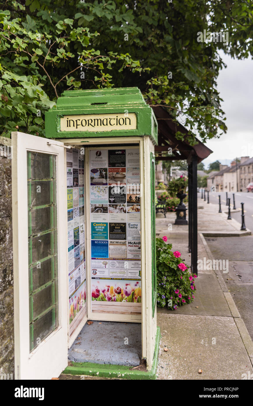 Disused Irish telephone box now serving as a community information information display board. - Stock Image