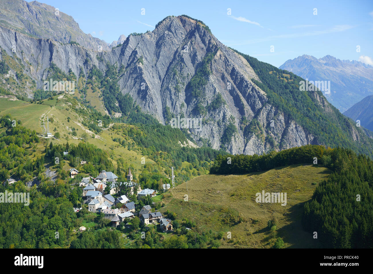 SMALL VILLAGE OF ORNON IN A RUGGED MOUNTAINOUS LANDSCAPE (aerial view). Auvergne-Rhone-Alpes, France. - Stock Image