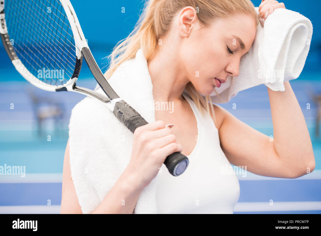 Exhausted Tennis Player - Stock Image