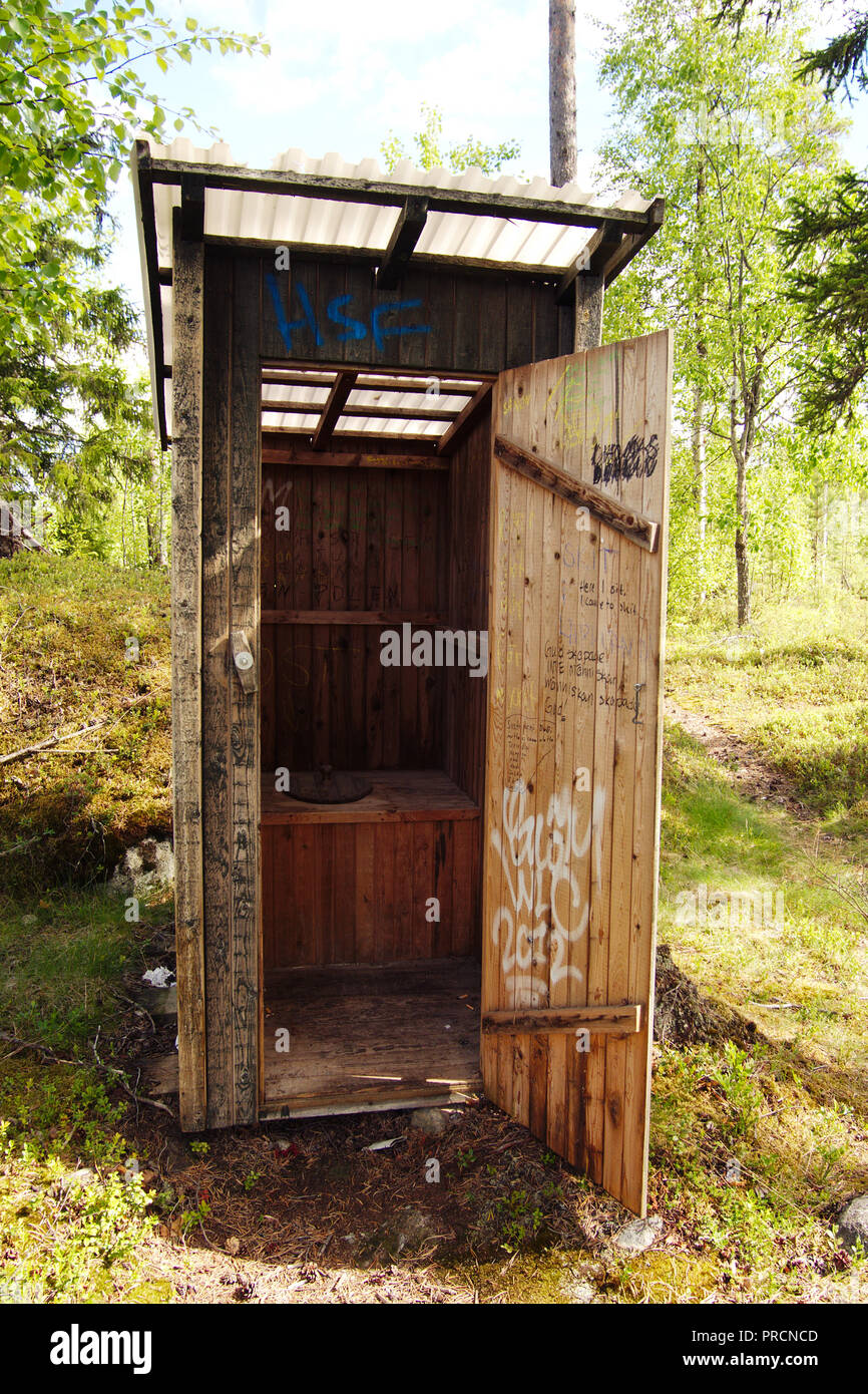 Composting toilet filled with graffiti at the Lappland border. - Stock Image