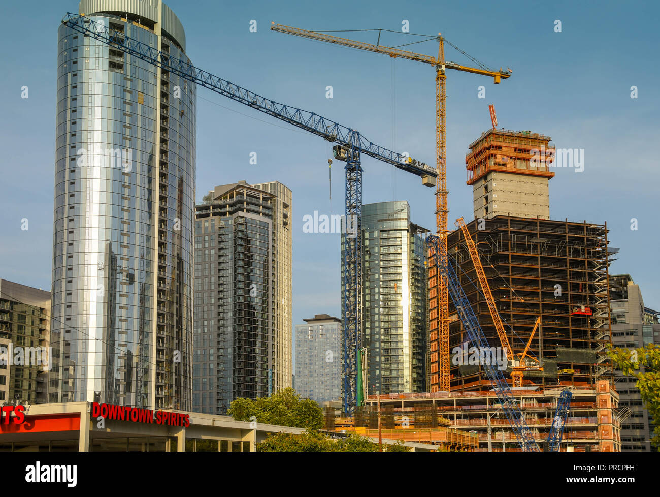SEATTLE, WA, USA, - JUNE 2018: Tower cranes working on a major new development in downtown Seattle. Stock Photo