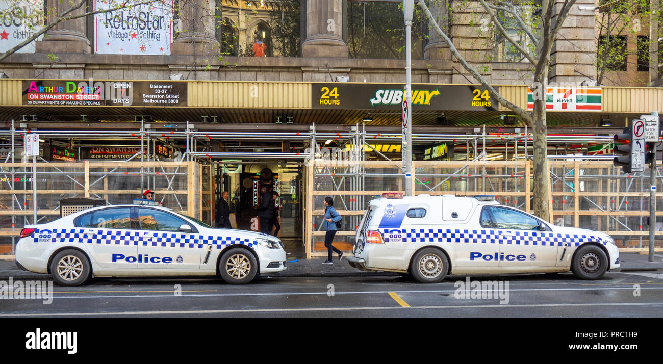 Two police vehicles parked on the road in Melbourne Victoria Australia. - Stock Image