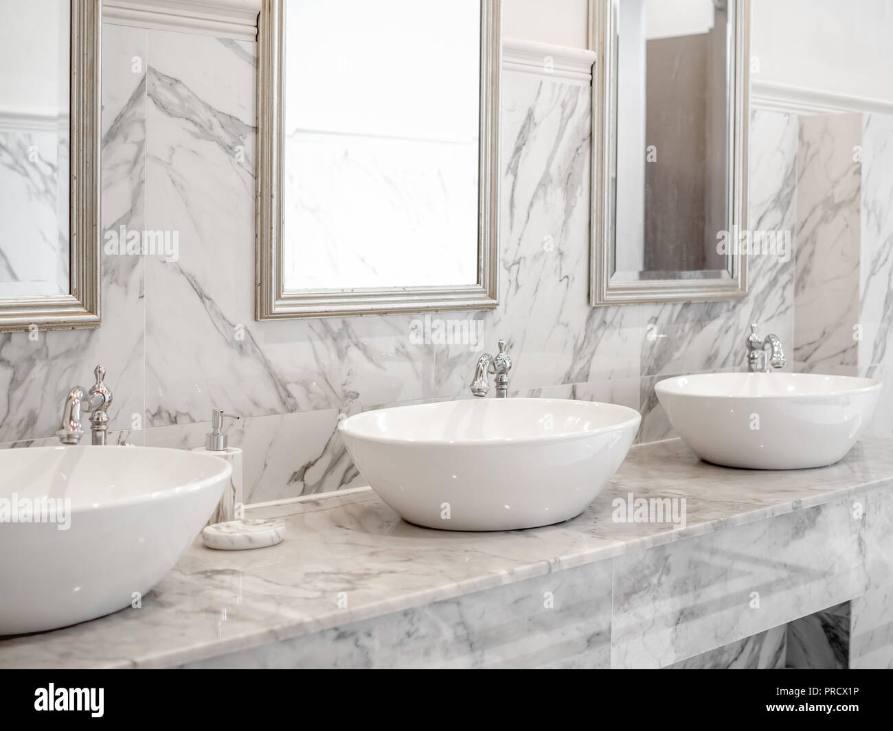 White Luxury Sink In Bathroom White Modern Interior Design Marble Bathroom With Three Round Wash Basin Aluminium Faucets And Mirrors On The Wall Stock Photo Alamy