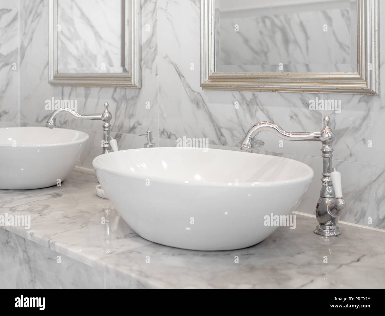 White Luxury Sink In Bathroom White Modern Interior Design Marble Bathroom With Round Wash Basin Aluminium Faucets And Mirrors On The Wall Stock Photo Alamy