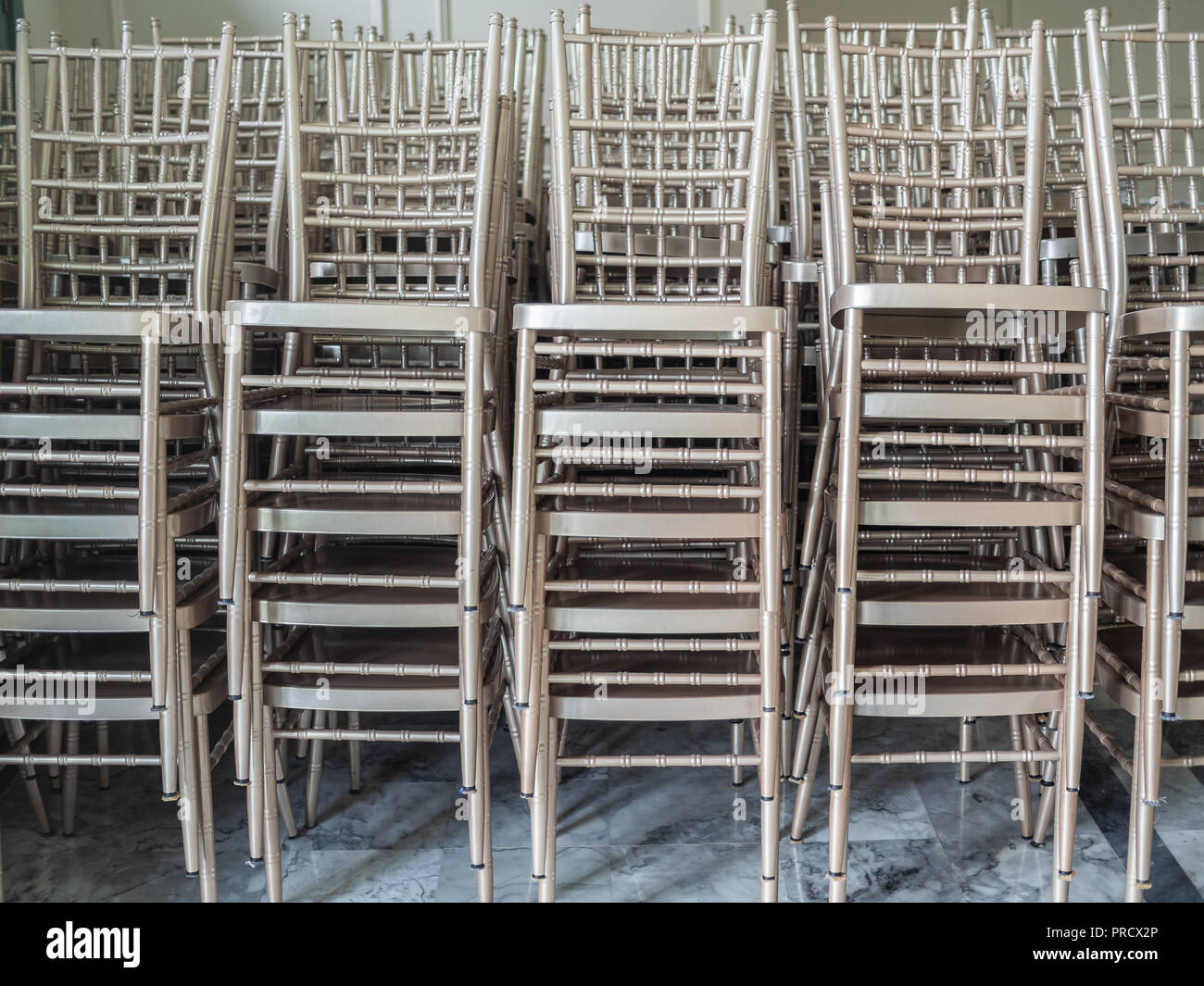 Groovy Rows Of Modern Stacked Silver Chairs On Marble Floor On Machost Co Dining Chair Design Ideas Machostcouk