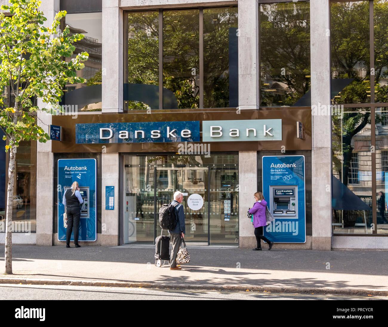 People using ATM at Danske Bank, Donegall Square West Belfast - Stock Image