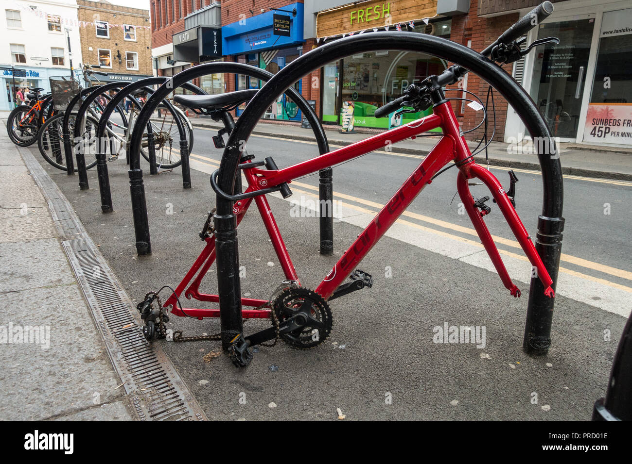 a bicycle which is locked up to a bike rack in windsor has had it s wheels stolen in an act of petty crime the bike frame is left abandoned stock photo https www alamy com a bicycle which is locked up to a bike rack in windsor has had its wheels stolen in an act of petty crime the bike frame is left abandoned image220946922 html