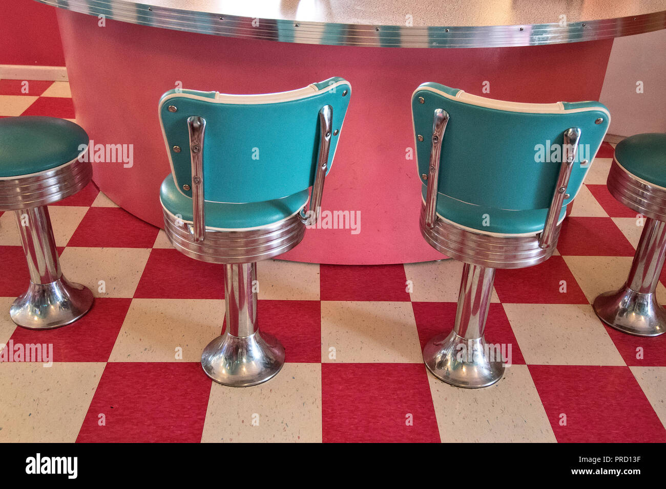 Diner stools at Twistee Treat Diner and Pink Elephant Antique Mall on Route 66, Livingston, Illinois, USA. - Stock Image
