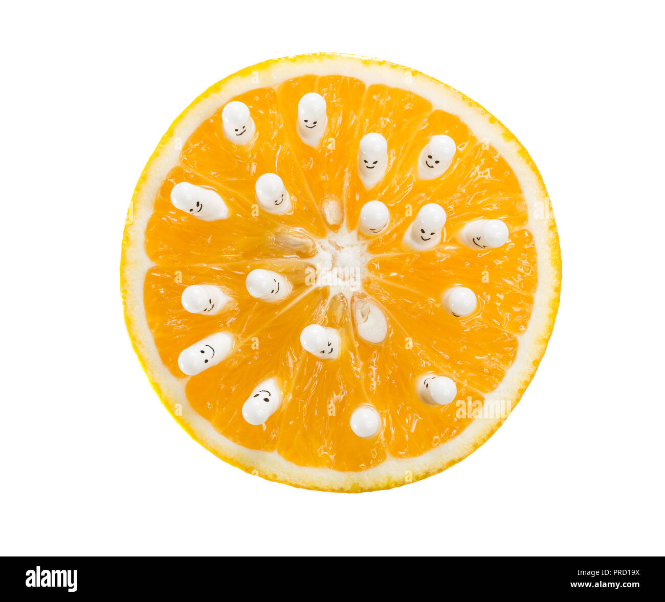 Funny capsules with vitamins from half an orange. - Stock Image