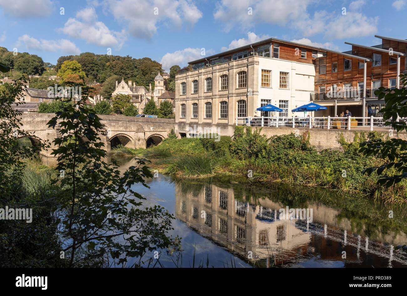 Bradford on Avon town bridge and Kingston Mills with refelctions in the River Avon, Wiltshire, UK - Stock Image