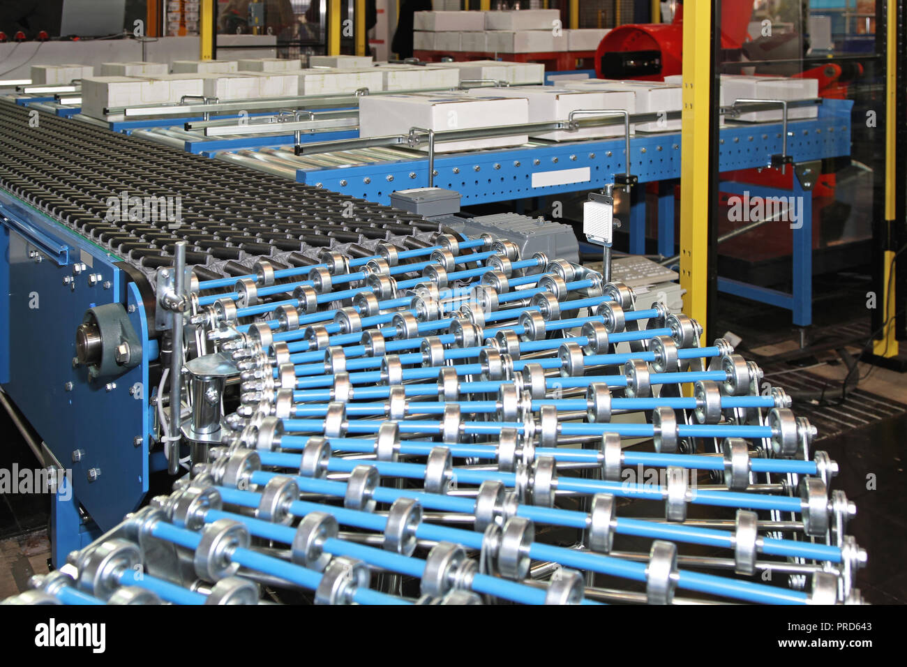 Flexible Conveyor Rollers at Box Packing Line in Factory Stock Photo