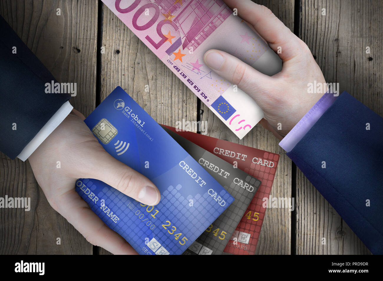 Two fiat currency bills being exchanged by two business people as part of a business transaction. - Stock Image