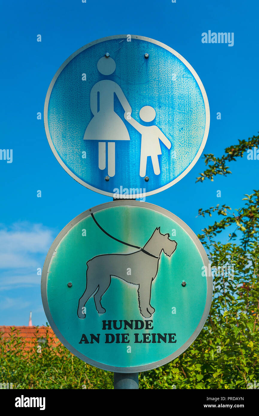 Mandatory signs, pedestrian path and dogs on a leash, Munich, Upper Bavaria, Bavaria, Germany - Stock Image