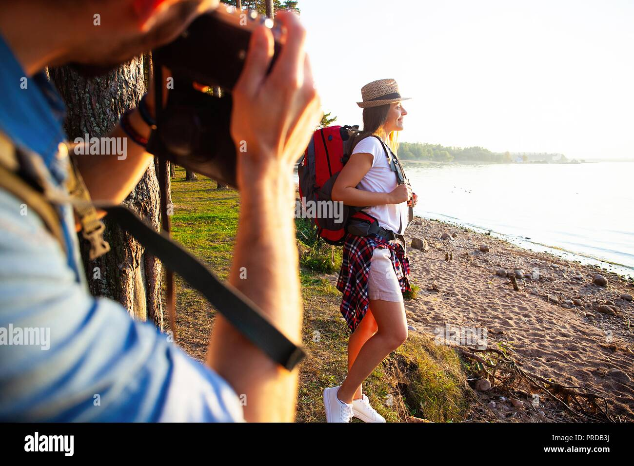 Happy young couples traveler with backpack take photo at forest, Travel and hiking concept.Stock Photo