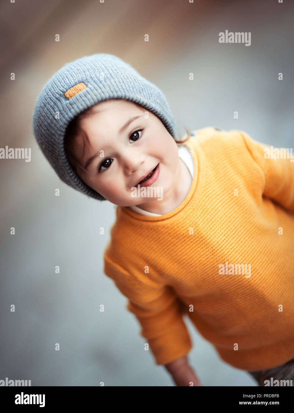 94ebbf979a8 Portrait of a cute happy smiling little baby wearing stylish warm clothes