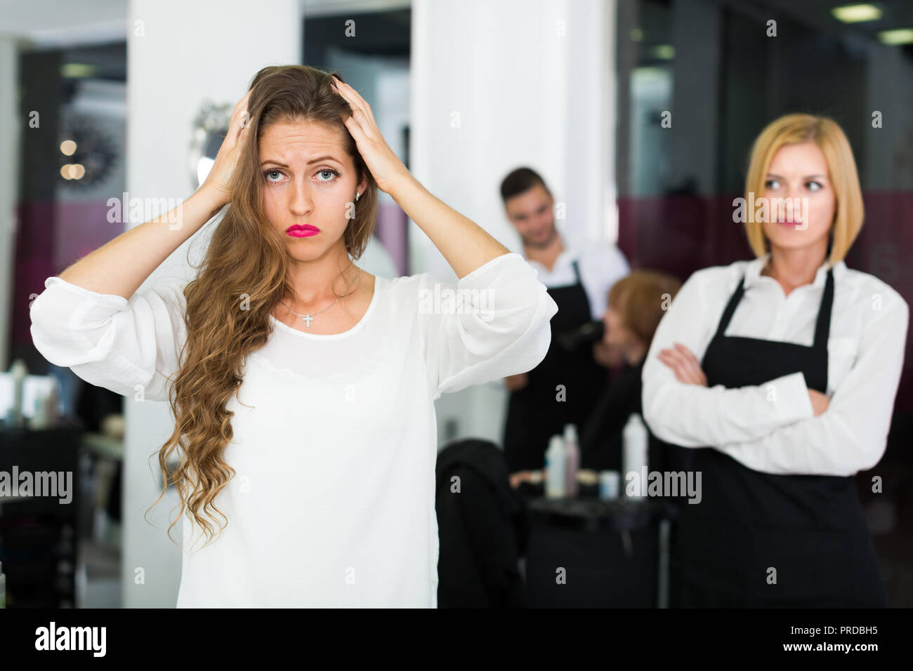 Woman client dissatisfied haircut in the barbershop - Stock Image
