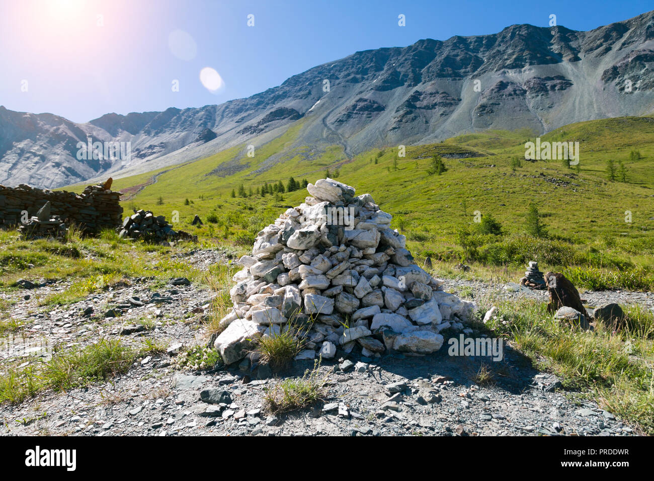 Marble stones are built up by a mountain, a sacred place of worship of pagans. - Stock Image