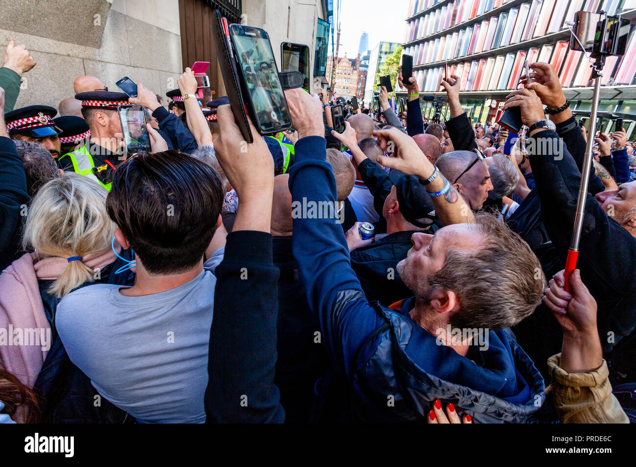 Supporters Of The Right Wing Activist Tommy Robinson Film Him With Their Mobile Phones Leaving 'The Old Bailey' Court, London, UK - Stock Image