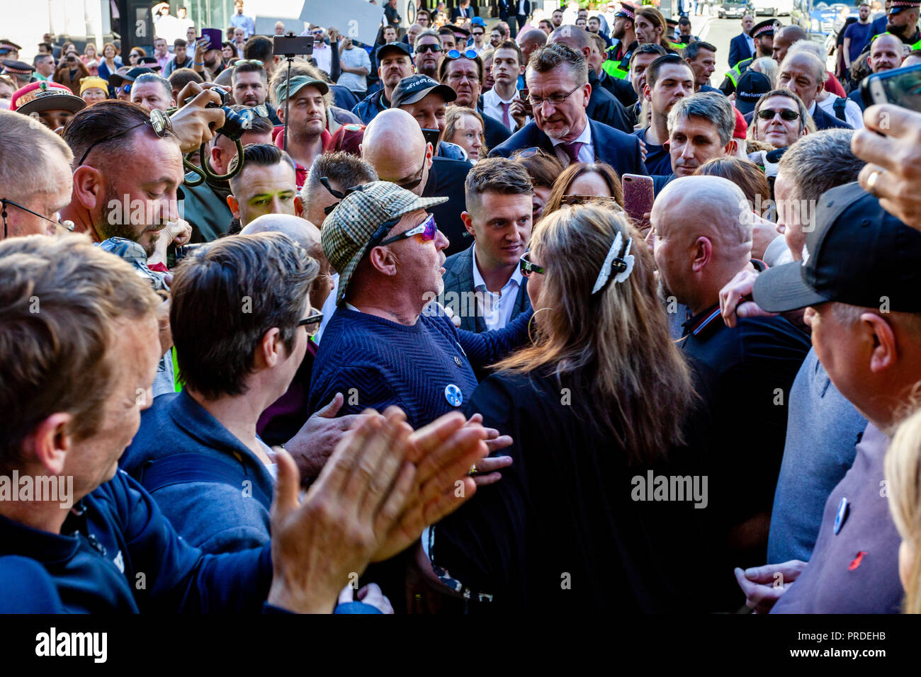 Right Wing Activist Tommy Robinson Is Surrounded By His Supporters At The Old Bailey After His Charge For Contempt of Court Is Adjourned, London, UK - Stock Image