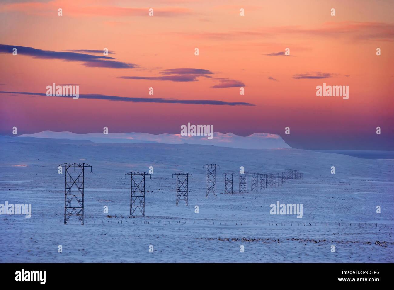 Power lines in the winter, Holtavorduheidi heath, Northern Iceland - Stock Image