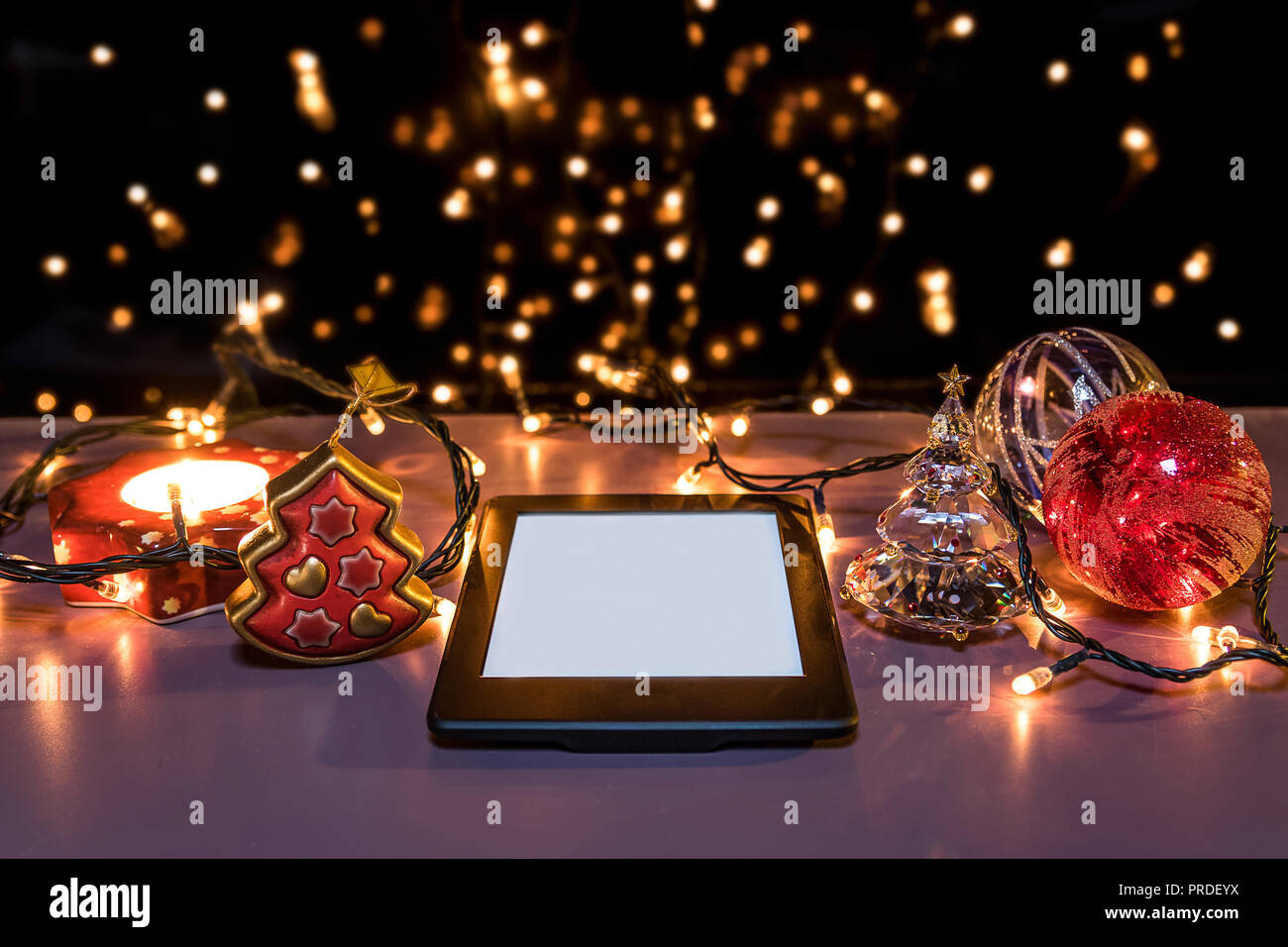 E reader on flat surface, perspective view, christmas theme - Stock Image