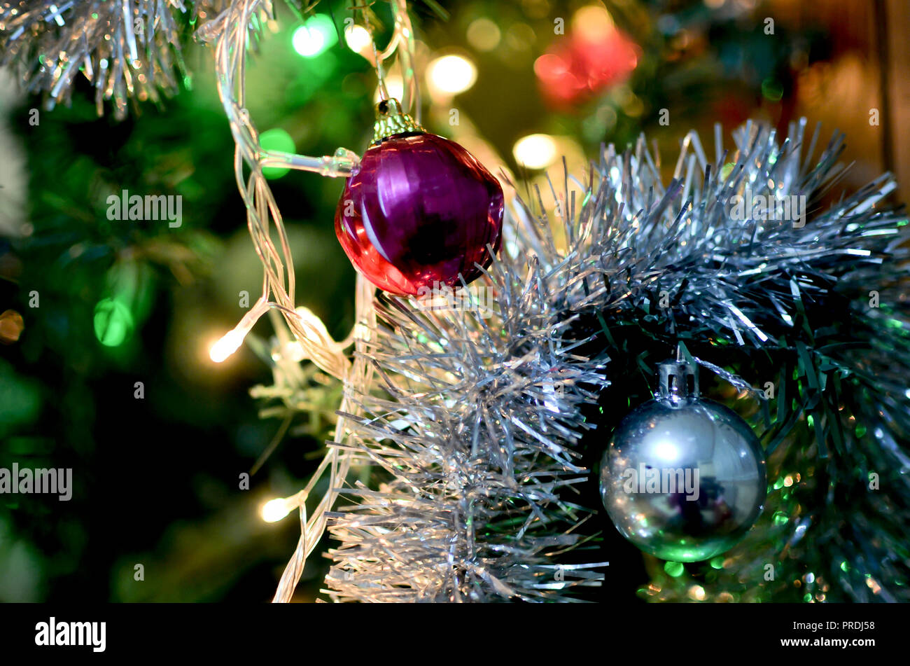 Red and Silver Christmas balls on tree in a winter scene. Beautiful ...