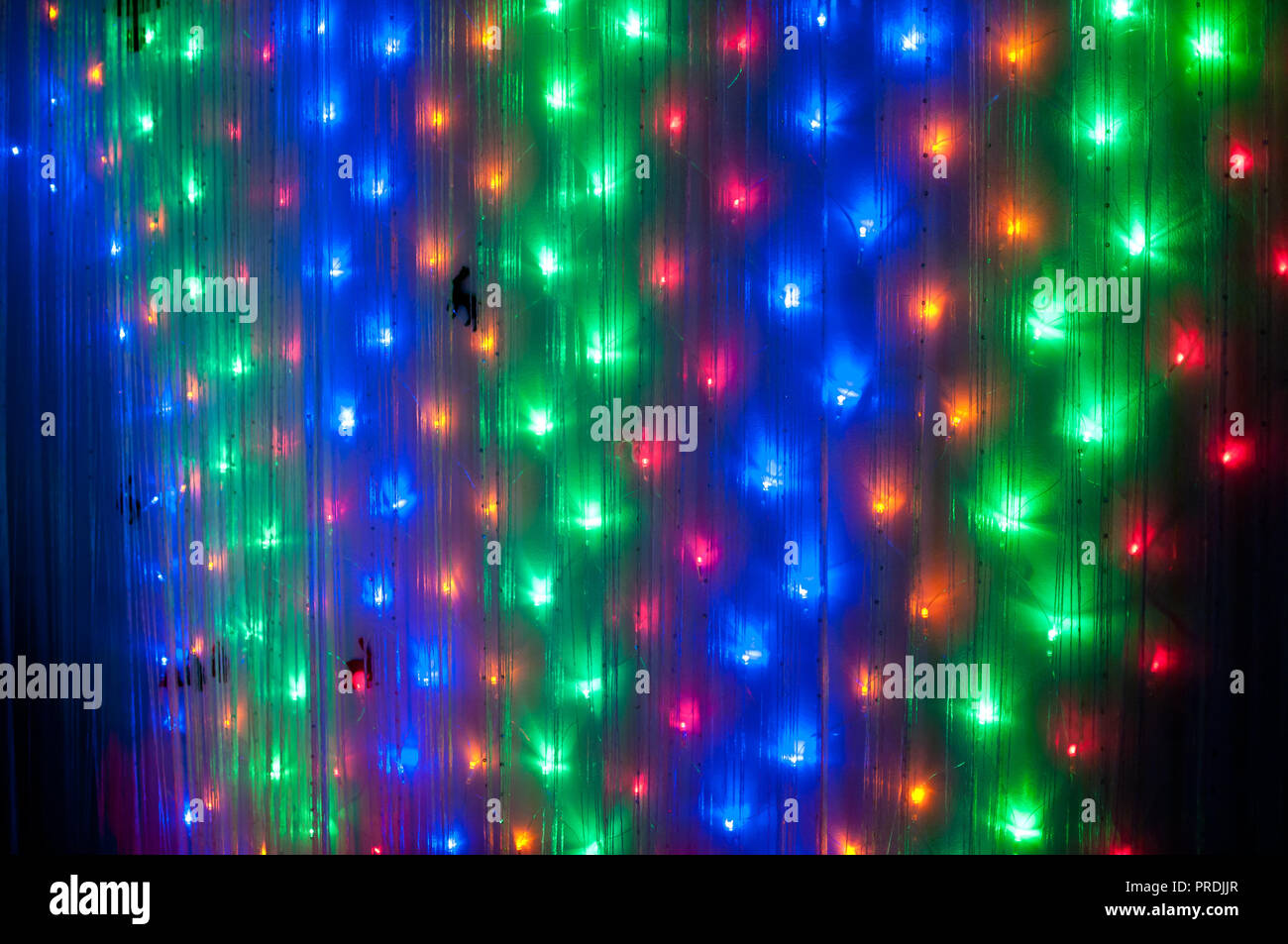 small colorful lights on wall as decoration for new year party lighting background