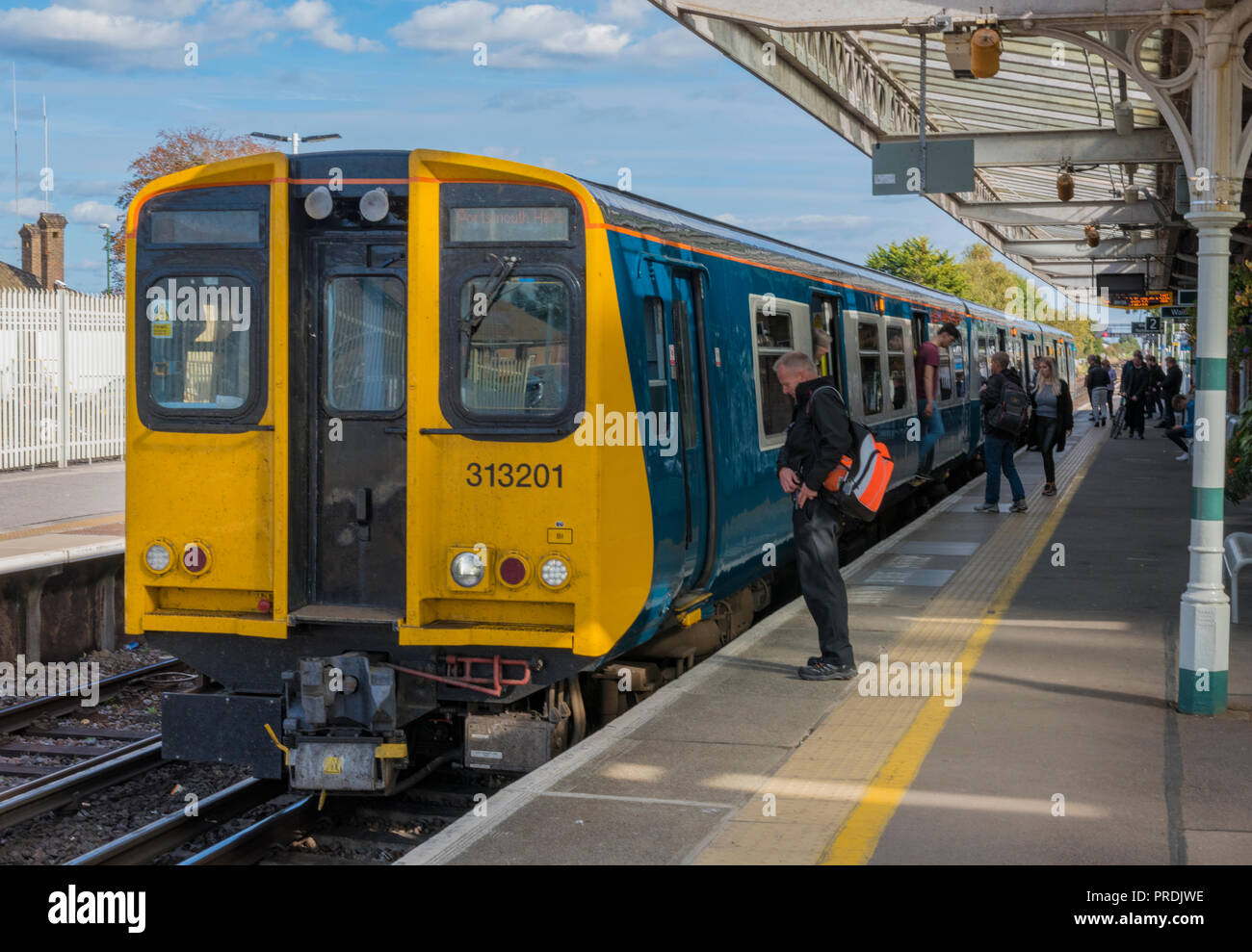 class 313 electric multiple unit train in the platform on the southern railway at barnham, west sussex. - Stock Image