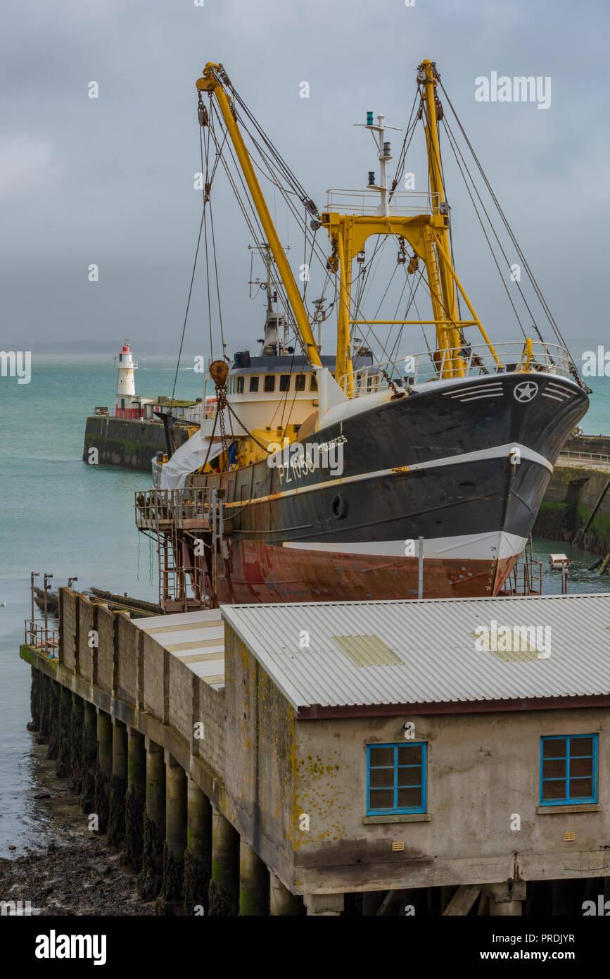 deep sea fishing trawler in dry dock on a slipway at Newlyn in Cornwall near Penzance. - Stock Image