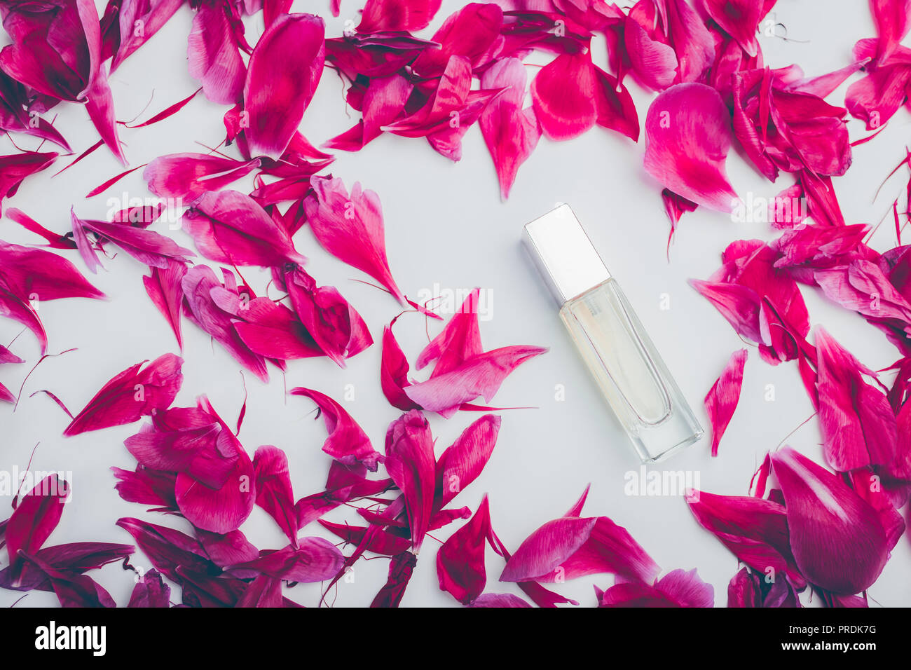 Bottle of perfume with pink peony petals on white background flower bottle of perfume with pink peony petals on white background flower fragrance organic cosmetics natural ingredients top view mightylinksfo