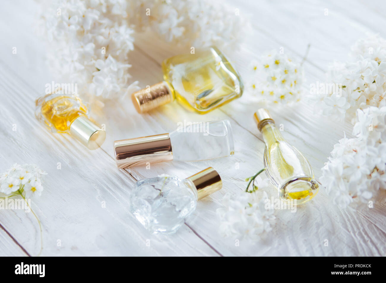 Bottles of perfume with white flowers on wooden background stock bottles of perfume with white flowers on wooden background mightylinksfo