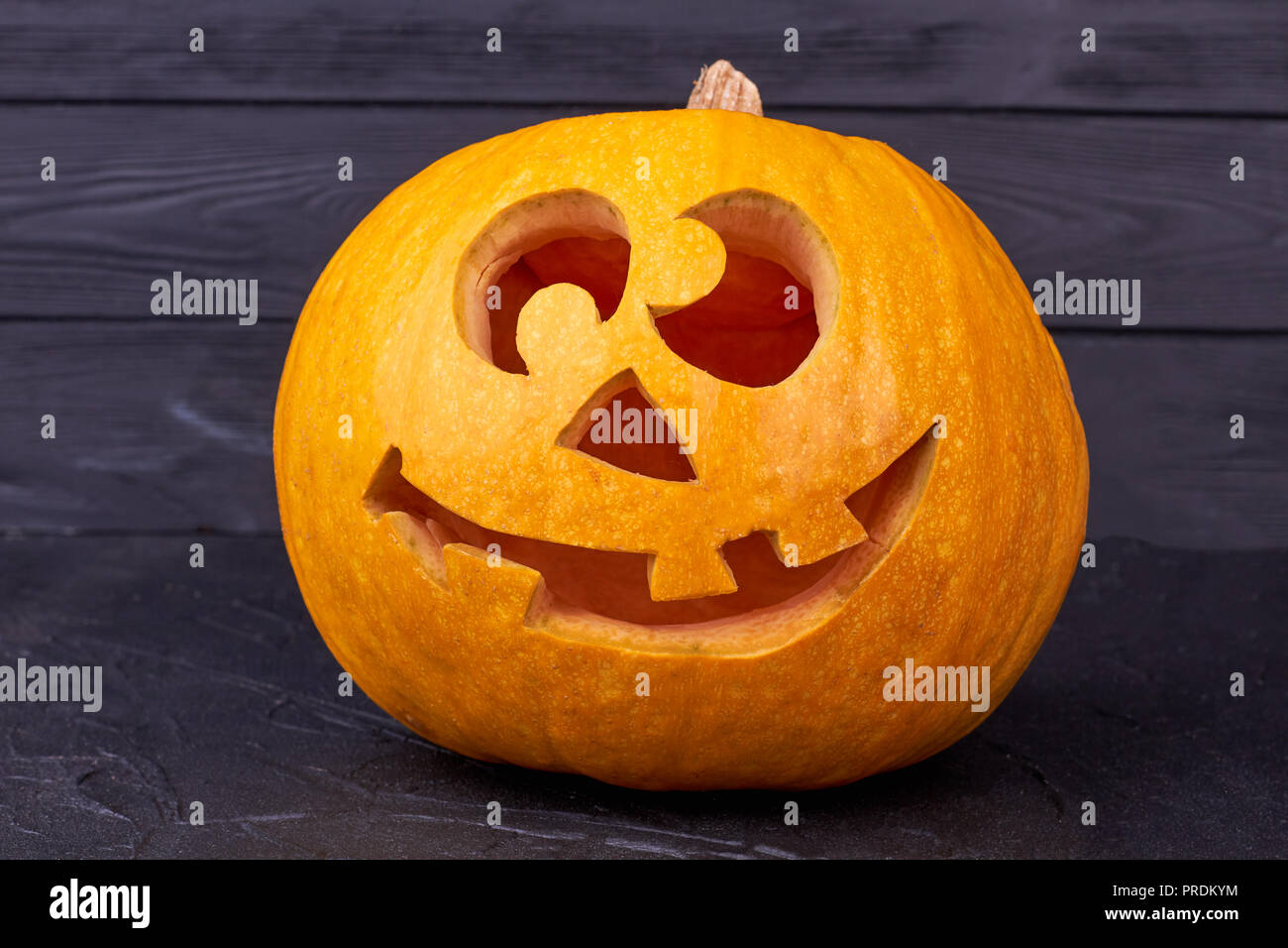 Halloween Pumpkin With Funny Face On Black Background Stock Photo