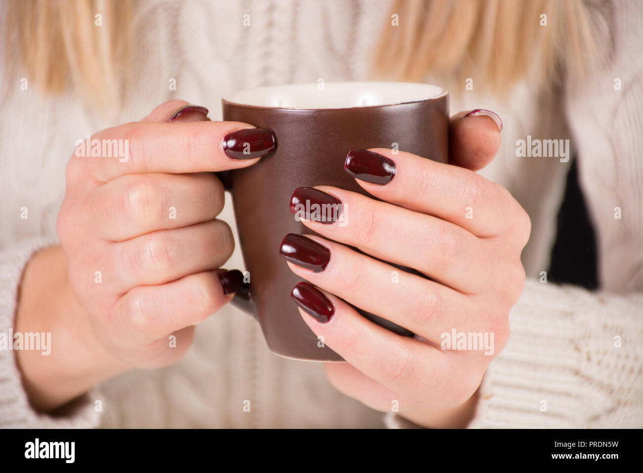 Girl With Cup Of Coffee And Brown Nails Polish Woman Wears Beautiful Sweater Manicure And Autumn Concept Close Up Selective Focus Stock Photo Alamy