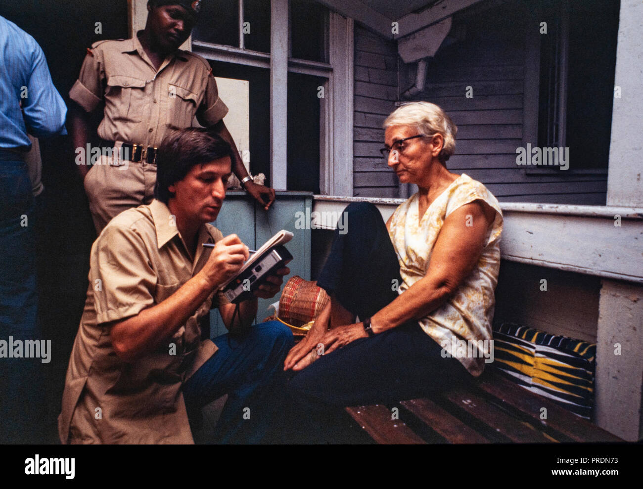 A Jonestown survivor talks with reporters. Jonestown was a remote settlement established by the Peoples Temple, an American cult under the leadership of reverend Jim Jones, in north Guyana. It became internationally notorious when, on November 18, 1978, a total of 918 people died. - Stock Image