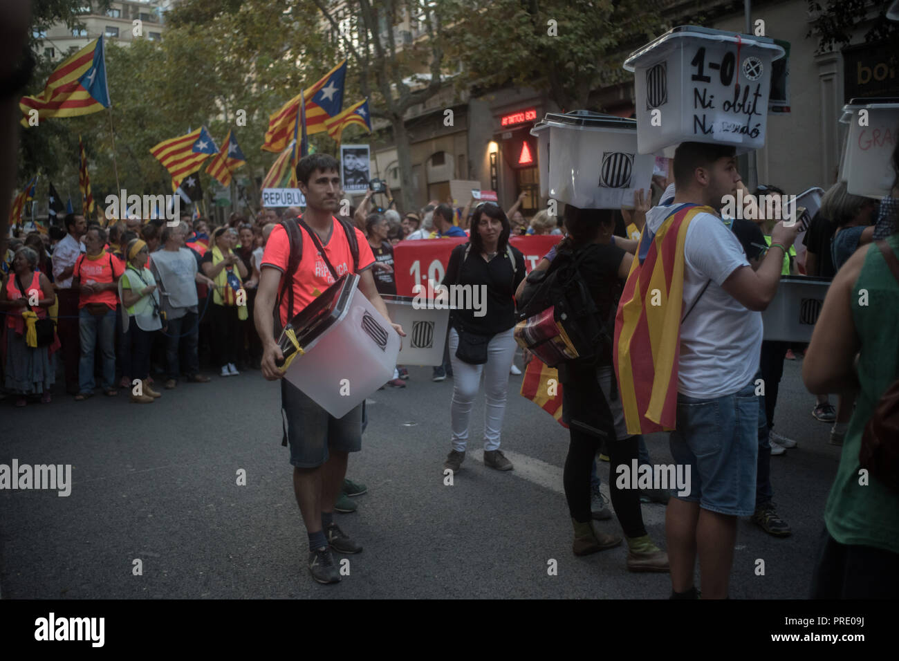 October 01, 2018 - Barcelona, Catalonia, Spain - People holding  ballot boxes used on past independence referendum banned by Spanish kingdom goes by  Barcelona streets on first October 2018. Thousands marched in Barcelona remembering the referendum on independence held a year ago that led hundreds of injured voters due the Spanish police crackdown. - Stock Image