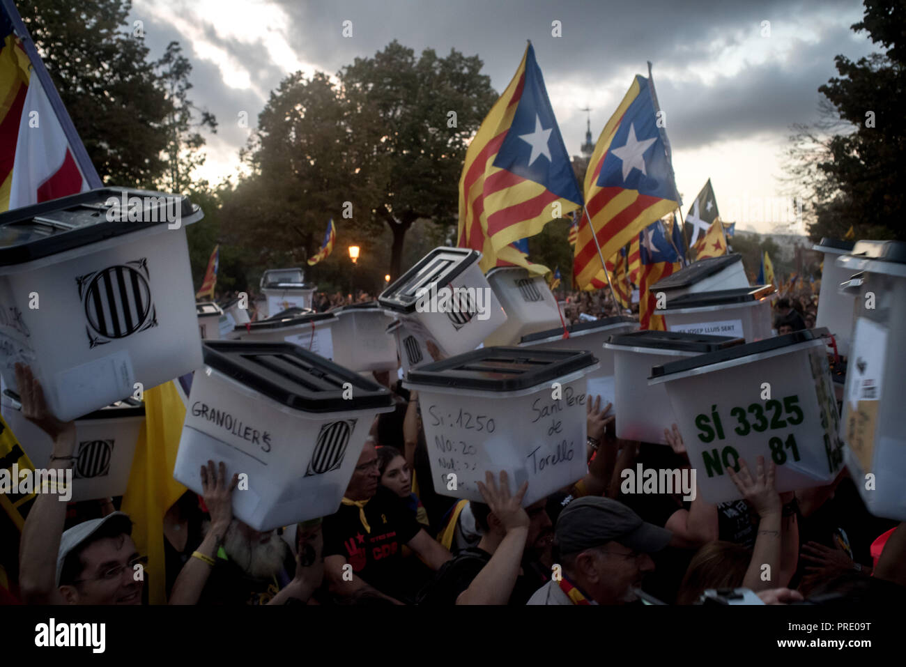 October 01, 2018 - Barcelona, Catalonia, Spain - People holding  ballot boxes used on past independence referendum banned by Spanish kingdom goes by  Barcelona  on first October 2018. Thousands marched in Barcelona remembering the referendum on independence held a year ago that led hundreds of injured voters due the Spanish police crackdown. - Stock Image